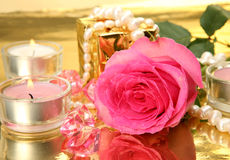 Pink rose and candles Royalty Free Stock Image