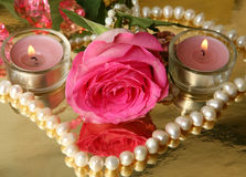 Pink rose and candles Royalty Free Stock Photography