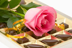 Pink rose and chocolate box Royalty Free Stock Photos