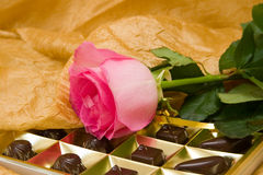 Pink rose and chocolate box Royalty Free Stock Photography