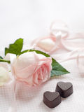 Pink rose with chocolate candy Stock Photography