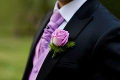 Pink Rose in a Dark Groom Suit Stock Photos
