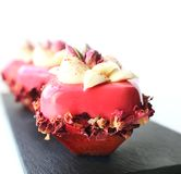 Pink rose desserts with white chocolate cream and dried petals royalty free stock images