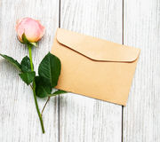 Pink rose and envelope Royalty Free Stock Photography