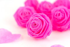 Pink rose fabric flower and small hart on white background Stock Photo