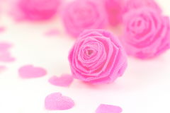 Pink rose fabric flower and small hart on white background Royalty Free Stock Photography