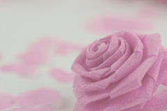 Pink rose fabric flower and small hart on white background Royalty Free Stock Images