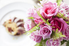 Pink rose flower on front of Beef medallions. With detail Royalty Free Stock Image