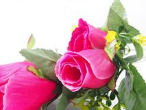 Pink rose flower, leafs of bouquet, made from plastic, fabric pattern Stock Image