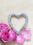Pink rose flowers, frame for text and hearts for Valentines Stock Photo