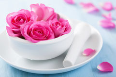 Pink rose flowers in mortar for aromatherapy and spa Royalty Free Stock Image