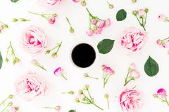 Pink rose flowers with mug of black coffee on white background. Flat lay, Top view stock image