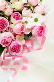 Pink rose flowers and ribbons on veil Stock Photo