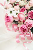 Pink rose flowers and ribbons on veil Stock Photography