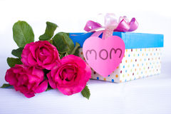 Pink rose and gift box at Mother's Day Stock Image