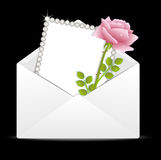 Pink rose and greeting-card in an envelope Stock Images