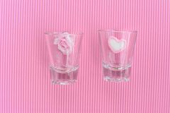 Pink rose and heart in drinking glass Stock Photo