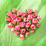 Pink rose heart on the green cloth. Drapery Royalty Free Stock Image