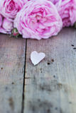 Pink rose heart. And on the old boards Royalty Free Stock Photos