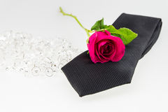 Pink rose on necktie with crystal on white Royalty Free Stock Images