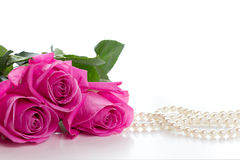 Pink rose and pearl necklace Royalty Free Stock Image