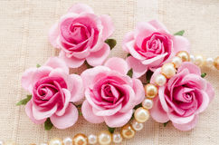 Pink rose with pearls. Stock Image