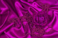 Pink rose and pearls on satin Royalty Free Stock Photo