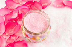 Pink rose on rose petals and bath salt Royalty Free Stock Photo