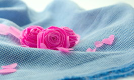 Pink rose and small hart on blue cloth background Stock Photo