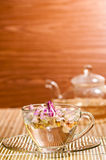 Pink rose tea in a glass teacup close up Stock Images