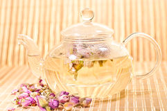 Pink rose tea in a glass teapot Stock Photo