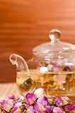 Pink rose tea in a glass teapot close up Royalty Free Stock Images