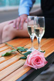 Pink rose and two wineglasses with champagne Royalty Free Stock Image