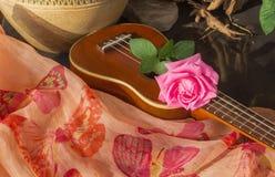 Pink rose on ukulele in boutique style Royalty Free Stock Image