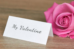 Pink rose with valentine note Stock Images