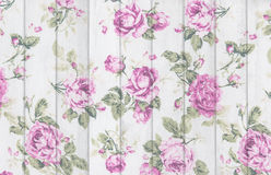 pink rose vintage from fabric on white wooden background Royalty Free Stock Images