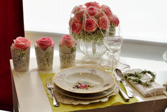 Pink rose on wedding reception table Royalty Free Stock Images