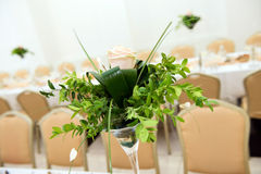 Pink rose on the wedding table Stock Images