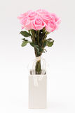 Pink rose in white vase Stock Photo