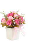 Pink rose in a white vase Stock Photos