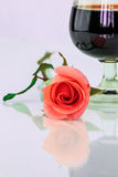 Pink rose and wine in glass Royalty Free Stock Photos