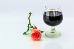Pink rose and wine in glass Stock Photography