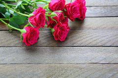 Pink rose on wooden background Stock Photo