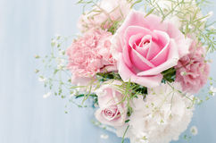 Pink Roses. Fresh bouquet of flowers isolated over light blue background Stock Photography