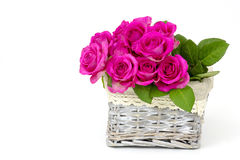 Pink roses in a basket Royalty Free Stock Photos