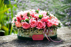 Pink roses. A beautiful flower composition with pink roses in box Stock Images