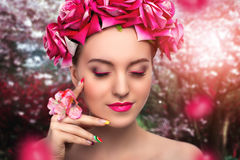 Pink roses and beautiful woman Stock Photo
