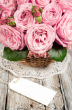 Pink roses  with blank label Stock Photo