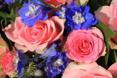 Pink roses and blue larkspur Stock Photo