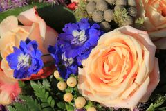 Pink roses and blue larkspur. In a floral wedding decoration Stock Photo